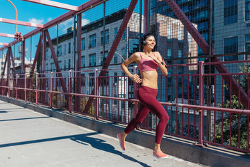 Young Beautiful Woman Running on the Streets Of New York City . Williamsburg Bridge
