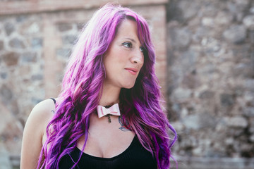 Portrait of a woman with purple hair