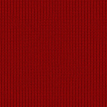 Knitted red pattern wool sweater texture close up