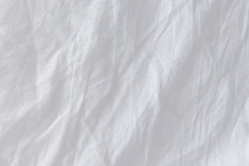 Top view of creased bedding sheets