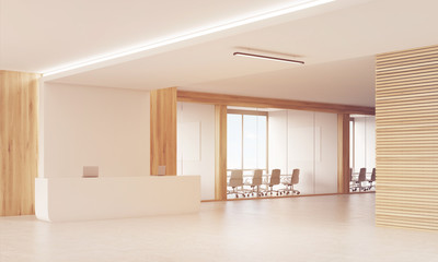 Sunlit reception counter with two conference rooms.