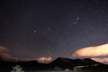 The starry sky captured Karoo National Park, South Africa, in winter. The Pleiades star cluster, Orion and Taurus Constellation clearly visible.