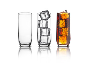 Glass of cola with ice cubes and empty glasses