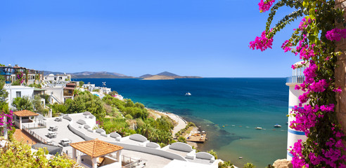 Beautiful flowers frame a sea view of Ortakent, Bodrum, Turkey