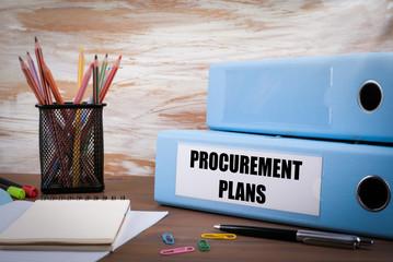 Procurement Plans, Office Binder on Wooden Desk. On the table co