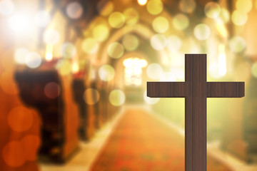 3D rendering of wooden cross in blurred church interior Fotomurales