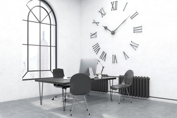 Office with large wall clock