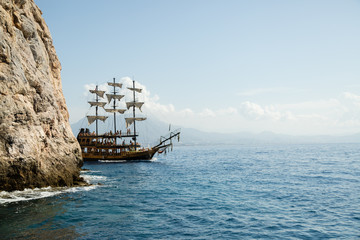 pirate ship on the sea with people