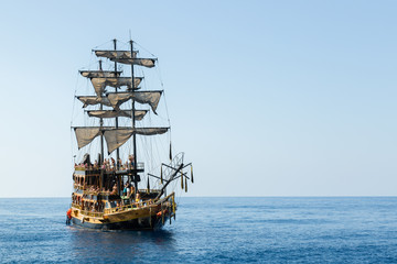 pirate ship with tourists at sea