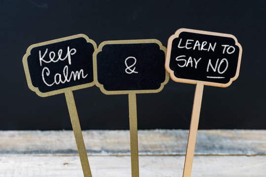 Keep Calm and Learn To Say NO message written with chalk on mini blackboard labels
