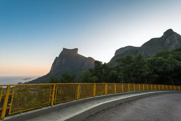 Wall Mural - Mountain Road with Pedra da Gavea and Pedra Bonita Rocks in the Horizon in Rio de Janeiro