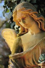 antique statue golden angel in the sunlight (Religion, faith, ho