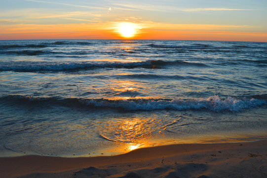 Brilliant sunrise over the waters of lake Huron in Oscoda, Michigan