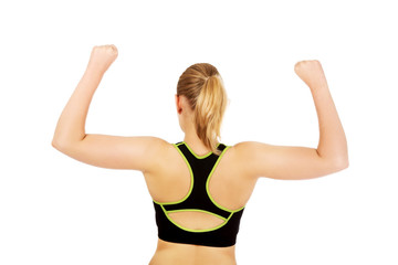 Back view of athletic woman showing muscles