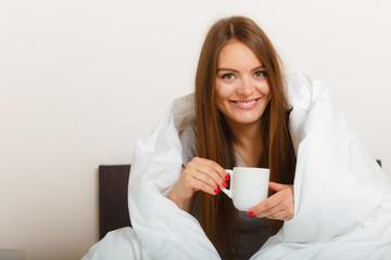Cheerful girl drinking coffee.