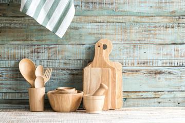 Kitchen cooking utensils in storage on the wood background