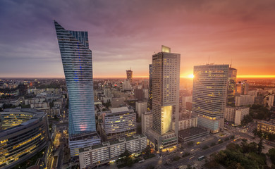 Warsaw Downtown, Poland. Sunset behind the building with lens flare