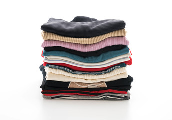 stacks of clothing on white