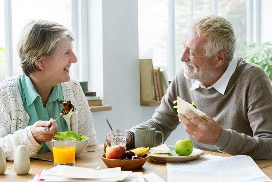 Pensioner Elderly Couple Eating Brunch Concept