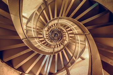 Foto op Plexiglas Trappen Spiral staircase in tower - interior architecture of building