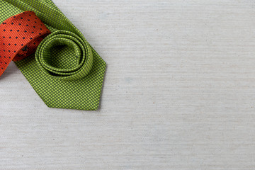 Design green and orange necktie on canvas background