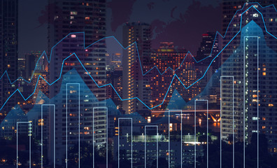 Trading graph on the cityscape at night and world map background
