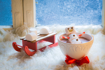Sweet and happy snowman for Christmas in hot chocolate