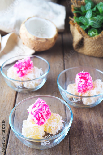 up of traditional asian steamed cassava cake with shredded coconut ...