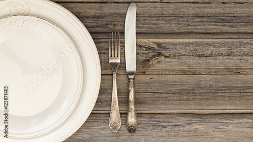 Table Setting Background dining setting or table setting of silverware or cutlery including