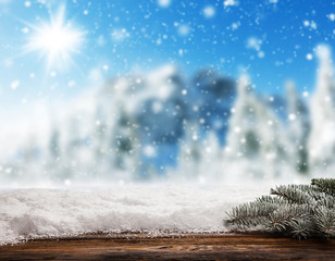 Empty wooden planks with snowy background