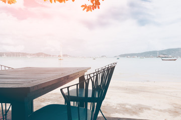 restaurant with table and chair near the beach