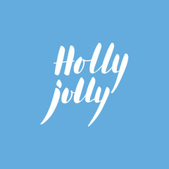 Calligraphic phrase Holly Jolly on blue background.