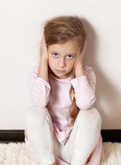 sad kid at the wall
