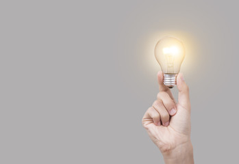 Business hand holding light bulb, concept of new ideas with new innovation and new creativity.