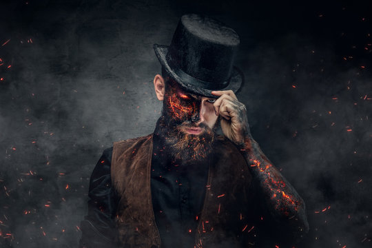 A man with burning face and arm.