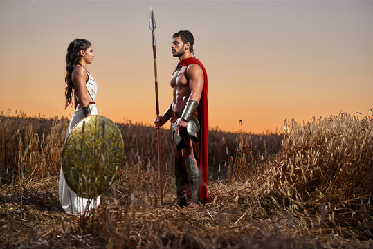 Spartan warrior and his woman in the field