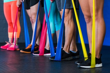 Athletes exercising with resistance band in gym Fotomurales