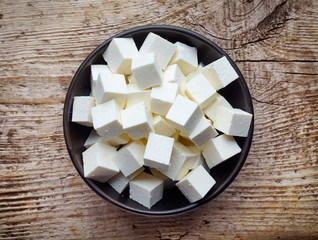 Bowl of soft cheese squares from above