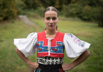 Young woman in slovakian clothes