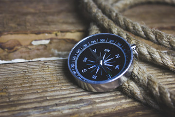 compass and rope on the table
