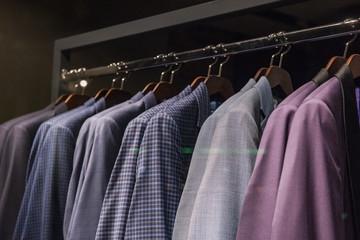 Elegant  suits in a men clothing shop.