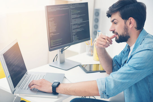 Young programmer coding in an office