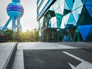 modern building entrance with the oriental pearl tower background,shanghai,china.