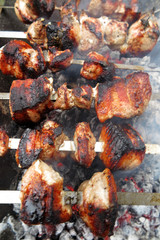 Pork shashlyk (shish kebab) roasting on skewers in the garden