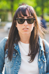 Portrait young beautiful woman wearing sunglasses