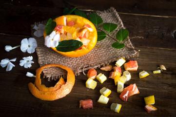Citrus set. Cut slices of orange, lemon and grapefruit on a wooden table.