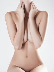 sexy woman covers her breast