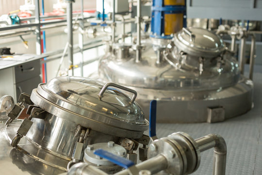 Tanks for chemical mixing.