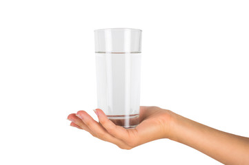 The glass of water in a female hand. On white, isolated background.