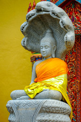 Buddha Image statue covering by Naga head.